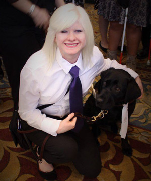 Gabrielle and Katie in matching purple collar and tie for a formal event