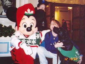 Macklin admires Mickey Mouse with his Christmas sweater.