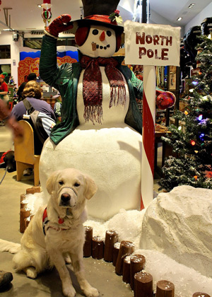 Cam'O sitting with a giant snowman. Cam'O is back to make the rounds of socializing.