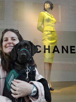 Amie and puppy in training Chanel in front of a Chanel store