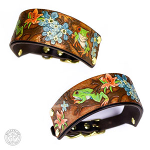 A BullyFlop collar featuring green tree frogs and colorful flowers on a woody brown background.